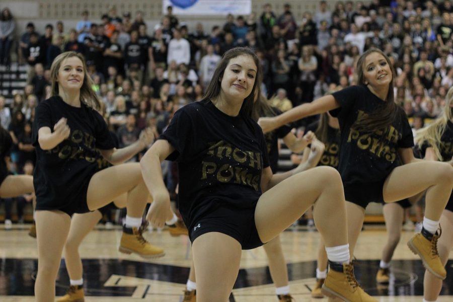 Members of the Poms team perform their new routine during the homecoming pep assembly