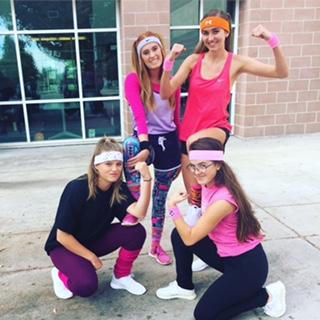 Senior Mikayla Dudek, Allie Reuter, Rachael Jacobs, and Zoe Schmanski show off their best workout looks on workout Wednesday