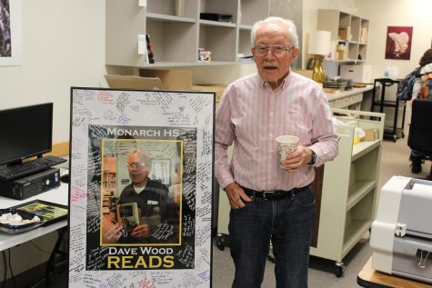 Dave Wood poses with a photo signed by the Monarch staff