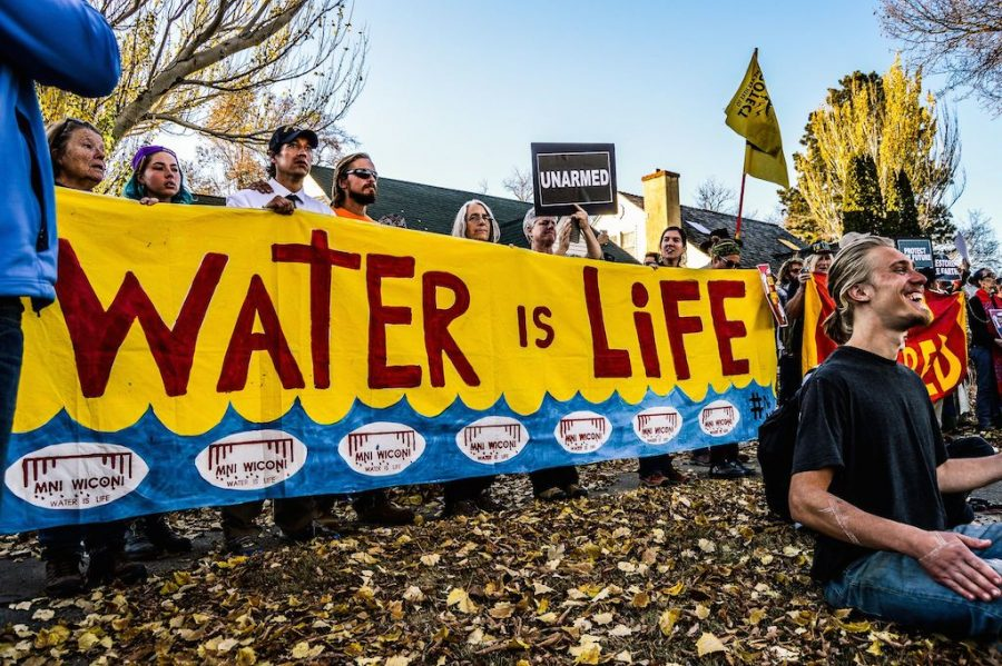 %22Water+is+Life.%22+Water+Protectors+and+Spiritual+Leaders+demonstrate+outside+the+Governor%27s+Mansion+in+Bismarck%2C+ND.+Photo+by+Rob+Wilson+Photography