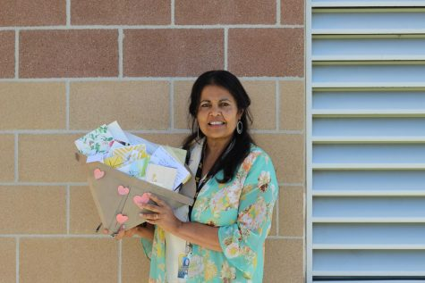 "Rupali Hofmann shows an envelope of letters she received from her students. The envelope is shaped like a heart and is filled with endless supportive and grateful letters. ""I receive more from kids than they do from me"" Hofmann said"