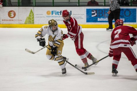 A shot from the Monarch vs. Regis hockey game