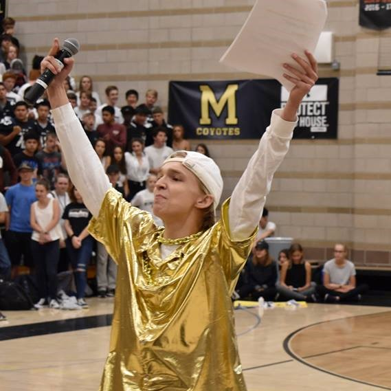 Head boy Connor Moore '19 hypes up the crowd during the Homecoming Assembly.