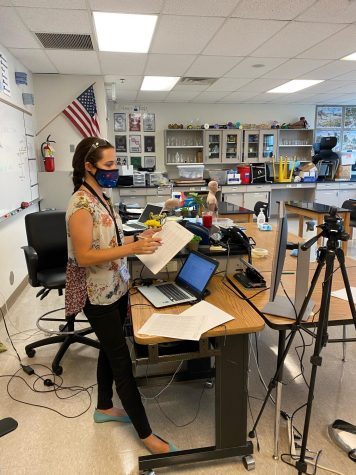 Science teacher Courtney Van der Linden talks to students in a hybrid classroom on the first day of in-person learning.